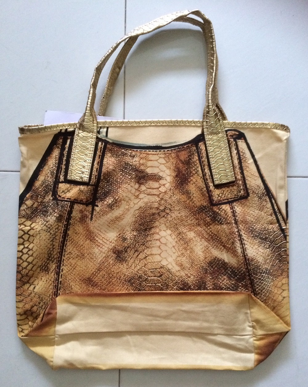 Marie Claire Sep 15, gold bag